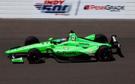 FILE PHOTO: Verizon IndyCar Series driver Danica Patrick (13) drives into turn one during practice for the 102nd Running of the Indianapolis 500 at Indianapolis Motor Speedway in Indianapolis, Indiana, U.S., May 17, 2018. Brian Spurlock-USA TODAY Sports/File Photo