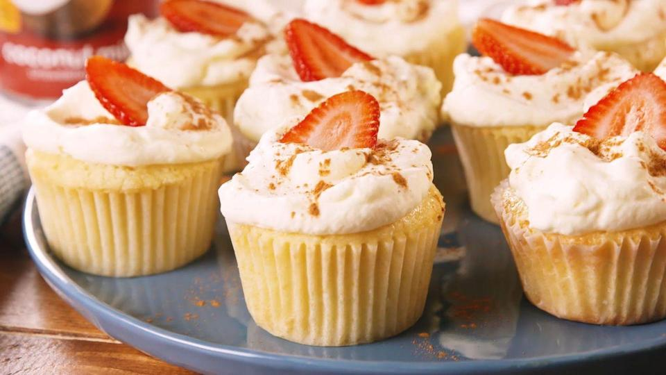 """<p>The longer you let them sit, the more coconut they'll absorb.</p><p>Get the recipe from <a href=""""https://www.delish.com/cooking/recipe-ideas/a29371533/tres-leches-coconut-cupcakes-recipe/"""" rel=""""nofollow noopener"""" target=""""_blank"""" data-ylk=""""slk:Delish"""" class=""""link rapid-noclick-resp"""">Delish</a>.</p>"""