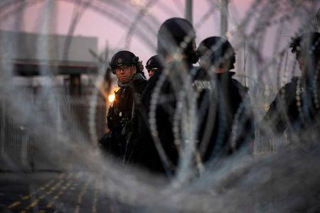 CBP Special Response Team officers stand near concertina wire at San Ysidro Port of Entry in Tijuana, Mexico