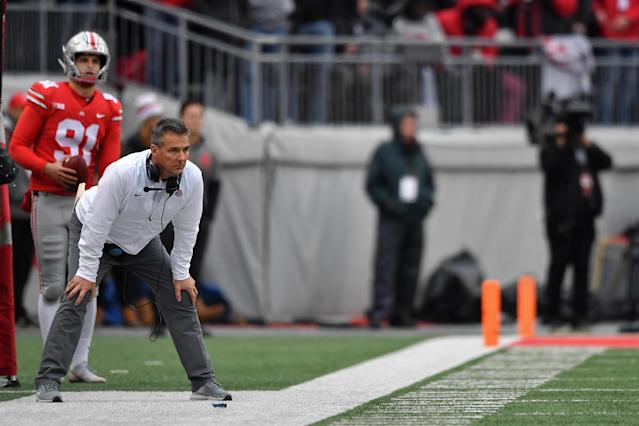 Urban Meyer of the Ohio State Buckeyes watches his team play against the Michigan Wolverines at Ohio Stadium on November 24, 2018 in Columbus, Ohio. Ohio State defeated Michigan 62-39. (Photo by Jamie Sabau/Getty Images)