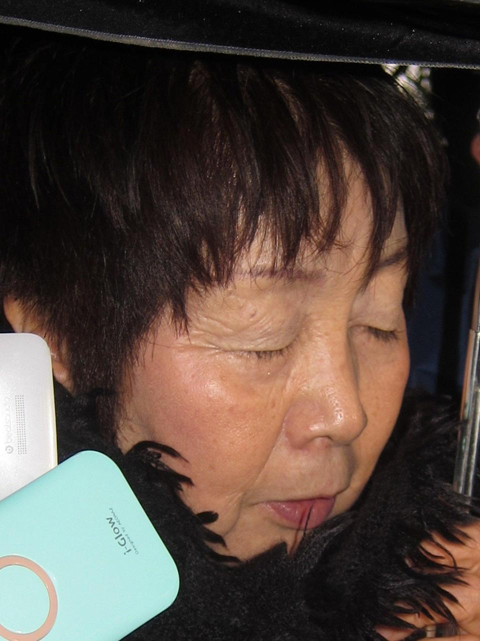 This picture taken on 13 March 2014 shows 67-year-old Japanese woman Chisako Kakehi, who was arrested in Kyoto on suspicion of poisoning her husband with cyanide in the latest 'Black Widow' case (AFP via Getty Images)