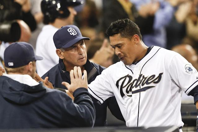 San Diego Padres' Everth Cabrera, right, gets the good word from San Diego Padres manager Bud Black after scoring against the Colorado Rockies in the fifth inning of a baseball game Wednesday, April 16, 2014, in San Diego. (AP Photo/Lenny Ignelzi)