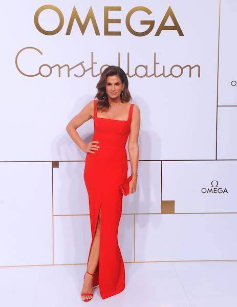 <p>Original super Cindy Craford opted for a slick red dress with co-ordinating accessories for the Omega event in Shanghai. <em>[Photo: Getty]</em> </p>