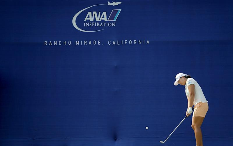 The LPGA elected to place a huge blue advertising hoarding across the back of the putting surface -Justin Thomas leads backlash against decision to place advertising hoarding at back of 18th green at the Ana Inspiration - GETTY IMAGES