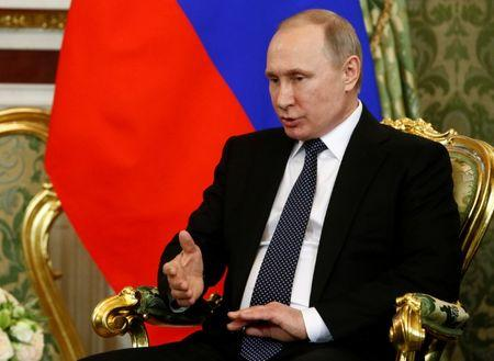 Russian President Putin speaks during meeting with Japanese PM Abe at Kremlin in Moscow