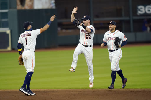 Valdez, Tucker lead Astros to 2-1 win over Rangers