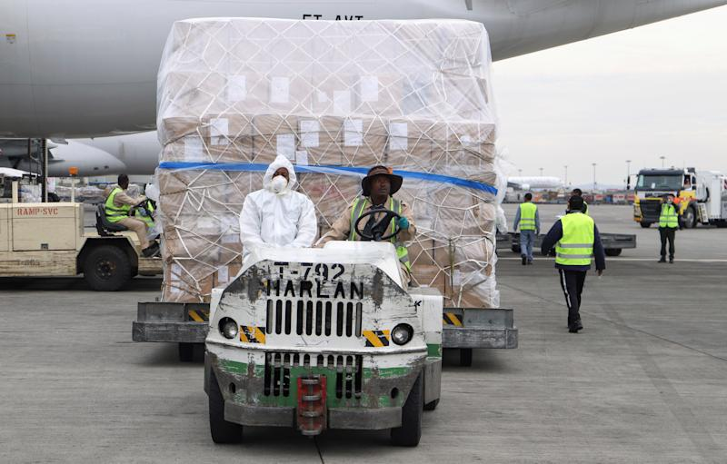 Ethiopian Airlines workers transport a consignment of medical donation from Chinese billionaire Jack Ma and Alibaba Foundation to Africa in Addis Ababa