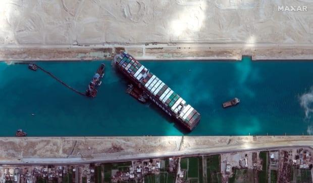 This satellite image from Maxar Technologies shows the cargo ship MV Ever Given stuck in the Suez Canal near Suez, Egypt, on March 28.
