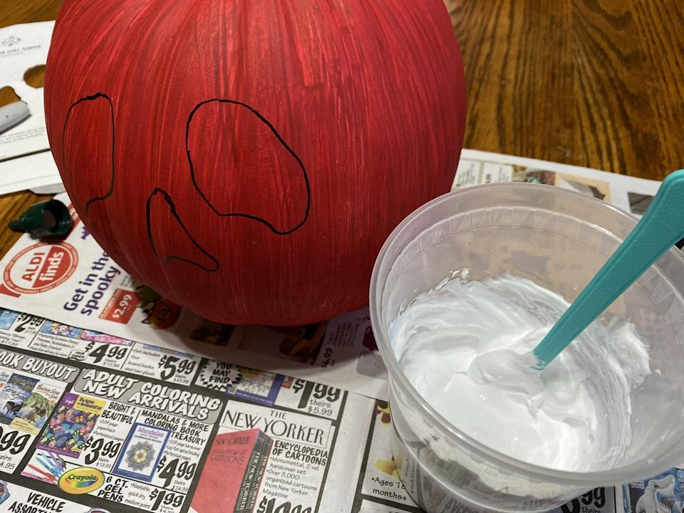 """<p>The poison on the apple is actually equal parts white school glue and shaving cream. Mix these together in a disposable cup or bowl for easy clean up. For an even spookier pumpkin you could add a few drops of green food coloring or paint to make the pumpkin look more like the poison apple from <a href=""""https://www.popsugar.com/love/Snow-White-Halloween-Costume-Inspiration-35780128"""" class=""""link rapid-noclick-resp"""" rel=""""nofollow noopener"""" target=""""_blank"""" data-ylk=""""slk:Snow White and the Seven Dwarfs""""><strong>Snow White and the Seven Dwarfs</strong></a>.</p>"""