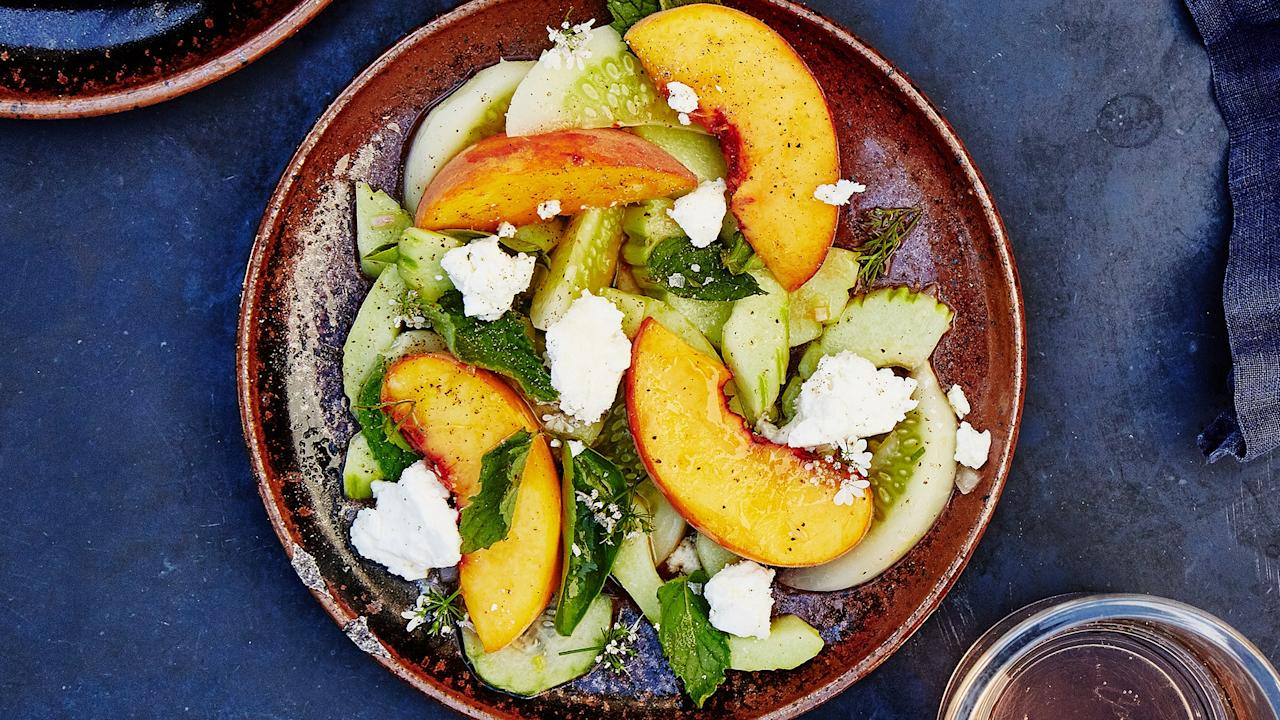 """You can use various heirloom cucumbers for this savory-sweet salad recipe; if you can find them, flaunt them. If not, just use a mix of mini and English hothouse cucumbers, which are available year-round. This recipe is by Kelly Mariani from <a href=""""https://scribewinery.com/"""">Scribe Winery</a> in Sonoma, CA. <a href=""""https://www.bonappetit.com/recipe/cucumber-and-peach-salad-with-herbs?mbid=synd_yahoo_rss"""">See recipe.</a>"""