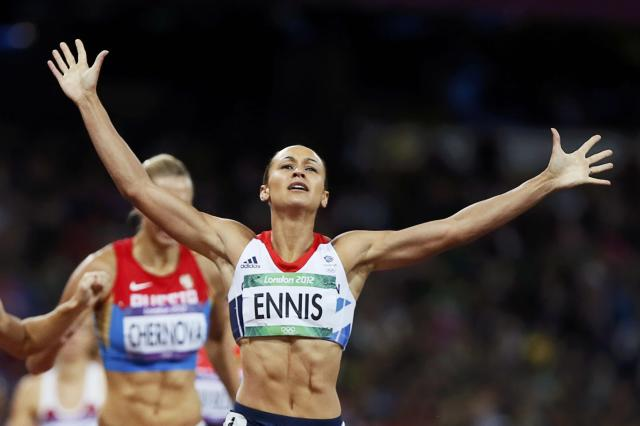 Britain's Jessica Ennis raises her arms as she wins her women's heptathlon 800m heat at the London 2012 Olympic Games at the Olympic Stadium August 4, 2012. REUTERS/Lucy Nicholson (BRITAIN - Tags: SPORT ATHLETICS OLYMPICS TPX IMAGES OF THE DAY) Picture Supplied by Action Images PLEASE NOTE: FOR EDITORIAL USE ONLY