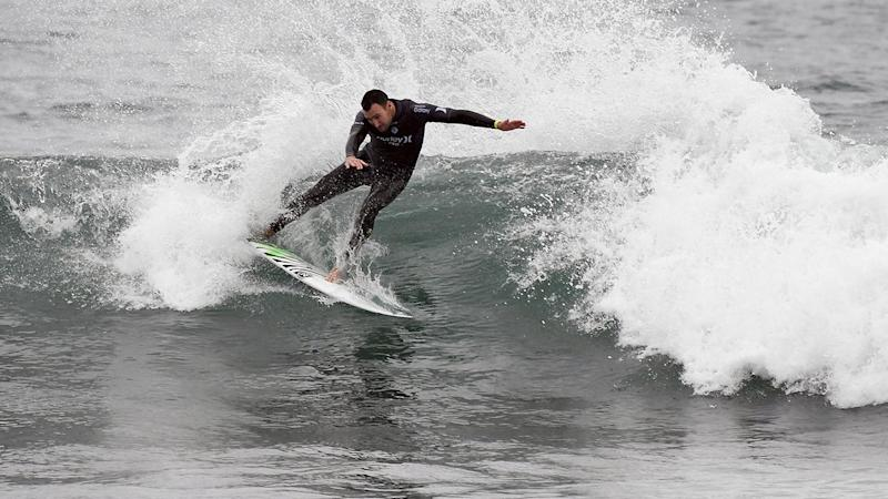 Aussie Joel Parkinson is through to the semi-finals of the World Surf League event in California.