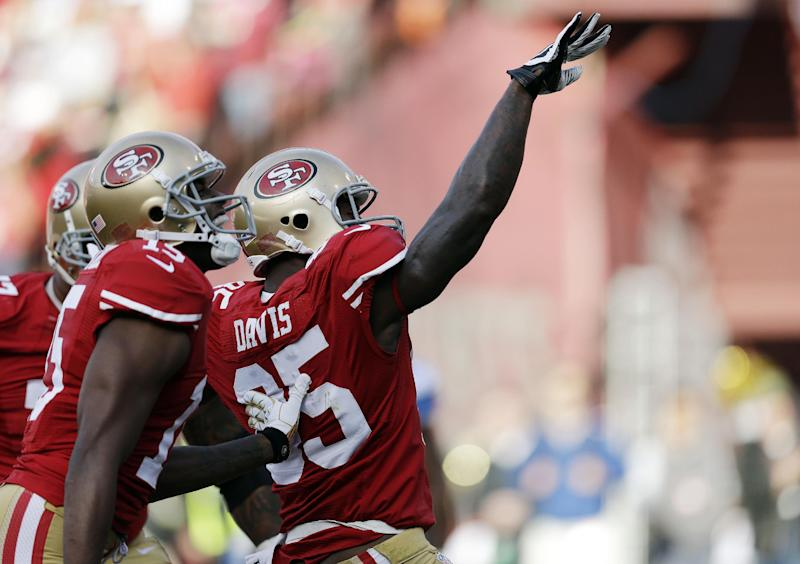 San Francisco 49ers tight end Vernon Davis, right, celebrates after scoring a touchdown on a pass reception during the first quarter of an NFL football game against the Detroit Lions in San Francisco, Sunday, Sept. 16, 2012. At left is wide receiver Michael Crabtree. (AP Photo/Marcio Jose Sanchez)