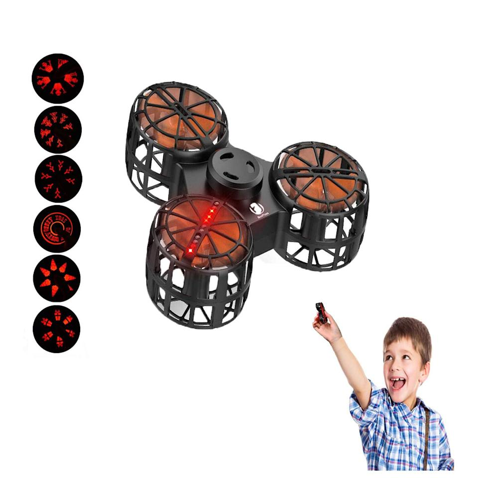 """<p>Want a fidget toy that doubles as a tiny drone? The <a href=""""https://www.popsugar.com/buy/EliveBuy-Flying-Fidget-Spinner-463448?p_name=EliveBuy%20Flying%20Fidget%20Spinner&retailer=amazon.com&pid=463448&price=16&evar1=moms%3Aus&evar9=46321064&evar98=https%3A%2F%2Fwww.popsugar.com%2Fphoto-gallery%2F46321064%2Fimage%2F46321080%2FEliveBuy-Flying-Fidget-Spinner&list1=toys%2Ckids%2Clittle%20kids%2Ckid%20shopping&prop13=api&pdata=1"""" rel=""""nofollow"""" data-shoppable-link=""""1"""" target=""""_blank"""" class=""""ga-track"""" data-ga-category=""""Related"""" data-ga-label=""""https://www.amazon.com/dp/B07KRWLVL9"""" data-ga-action=""""In-Line Links"""">EliveBuy Flying Fidget Spinner</a> ($16) works as both a traditional handheld fidget spinner and an interactive game. With a quick flip of the switch, the fidget spinner turns into a fun, flying toy with four flying modes to enjoy. </p>"""