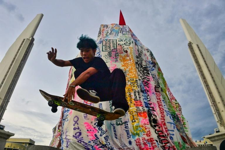 Kickflipping Thai skateboarders are flipping the bird at authorities, joining pro-democracy rallies in Bangkok to vent their anger (AFP/Lillian SUWANRUMPHA)