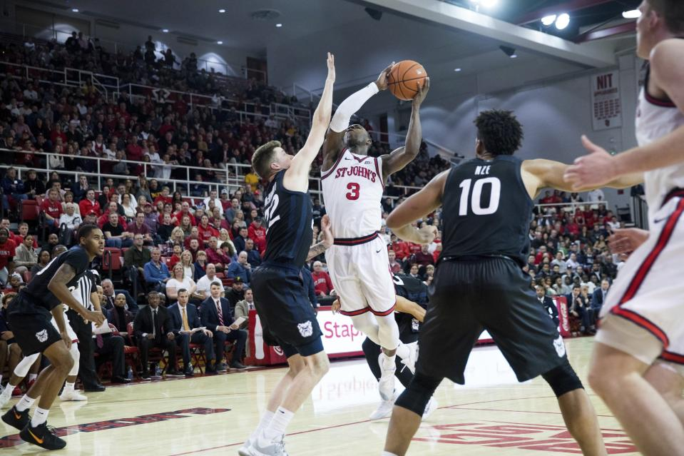 St. John's guard Rasheem Dunn (3) goes for the basket against Butler during the second half of an NCAA college basketball game, Tuesday, Dec. 31, 2019, in New York. (AP Photo/Julius Constantine Motal