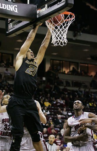Missouri's Laurence Bowers (21) dunks as South Carolina's RJ Slawson watches during the first half of their NCAA college basketball game, Thursday, Feb. 28, 2013, in Columbia, S.C. (AP Photo/Mary Ann Chastain)
