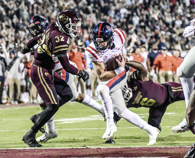 Mississippi quarterback John Rhys Plumlee (10) gets past Mississippi State safety Brian Cole II (32) and linebacker Willie Gay Jr. (6) to score during an NCAA college football game in Starkville, Miss., Thursday, Nov. 28, 2019. (Bruce Newman/The Oxford Eagle via AP)