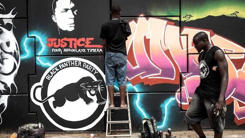 A member of Radikal Bomb Shot (RBS) collective, a collective of Senegalese artists, paints a mural depicting key American and African anti-racism activists, in a show of support for the Black Lives Matter movement in Dakar on June, 15, 2020.