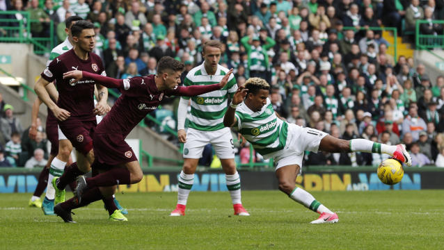 "Britain Football Soccer - Celtic v Heart of Midlothian - Scottish Premiership - Celtic Park - 21/5/17 Celtic's Scott Sinclair shoots at goal Reuters / Russell Cheyne Livepic EDITORIAL USE ONLY. No use with unauthorized audio, video, data, fixture lists, club/league logos or ""live"" services. Online in-match use limited to 45 images, no video emulation. No use in betting, games or single club/league/player publications. Please contact your account representative for further details."