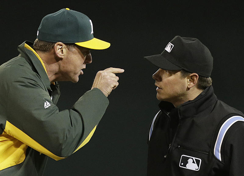 Oakland Athletics manager Bob Melvin, left, argues a called out at first base with umpire D.J. Reyburn in the eighth inning of a baseball game against the Texas Rangers Tuesday, May 14, 2013, in Oakland, Calif. Melvin was ejected from the game. (AP Photo/Ben Margot)