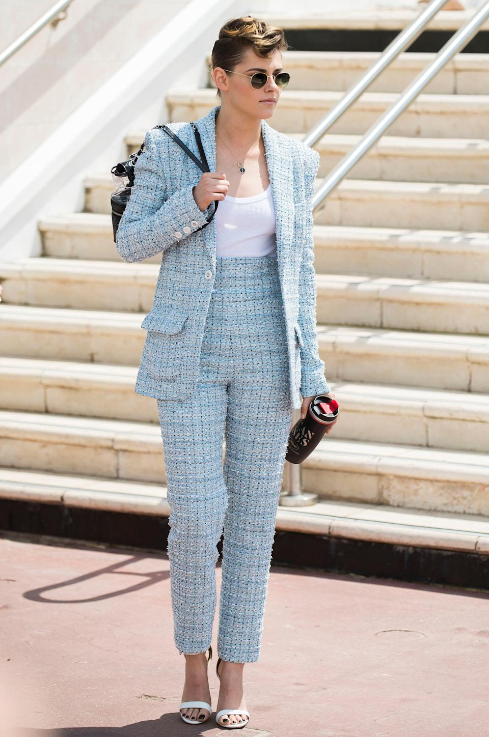 <p>The jury member arrived at the 71st international film festival in Cannes wearing a pale blue Chanel suit, white heeled sandals and sunnies. <em>[Photo: Rex]</em> </p>