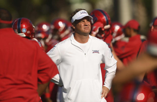 FILE - In this Oct. 6, 2018, file photo, Florida Atlantic head coach Lane Kiffin looks over his team during warm-ups before an NCAA college football game against Old Dominion, in Boca Raton, Fla. Kiffin has Florida Atlantic in the Conference USA title game for the second time in three years. The Owls play host to defending champion UAB on Saturday, Dec. 7, 2019, amid speculation that it might be Kiffin's farewell at FAU. (Jim Rassol/South Florida Sun-Sentinel via AP, File)