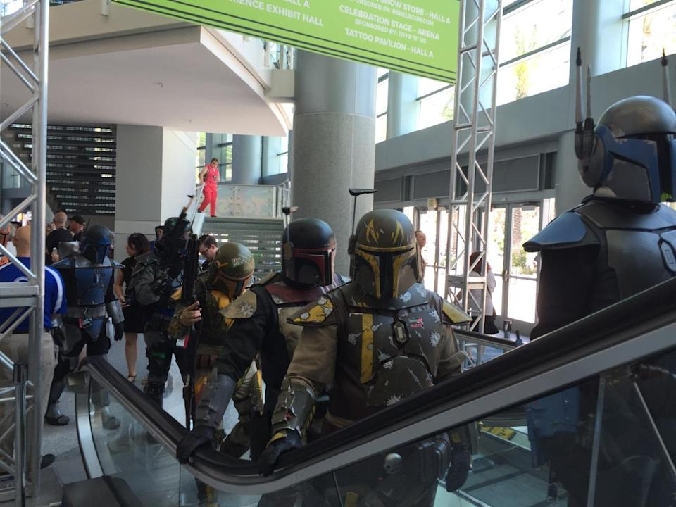 Jango Fett, Boba Fett, Freddy Fett… and all their pals, armored up in their finest regalia, take the escalator. Guess the Slave I was in the shop?