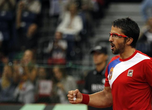 Janko Tipsarevic of Serbia celebrates a point won against Vasek Pospisil of Canada during their Davis Cup semifinal tennis match in Belgrade, Serbia, Sunday, Sept. 15, 2013. (AP Photo/Darko Vojinovic)