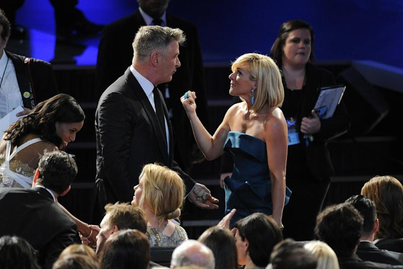 Kerry Washington, from left, Alec Baldwin and Jane Krakowski appear at the 65th Primetime Emmy Awards at Nokia Theatre on Sunday Sept. 22, 2013, in Los Angeles. (Photo by Chris Pizzello/Invision/AP)