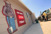 """A sign with the character """"Smokey The bear"""" warns of extreme fire danger as a wildfire continues to burn near Livermore, Colo., on Saturday, June 23, 2012. Authorities sent out 992 evacuation notices Friday due to the wildfire burning on more than 100 square miles in northern Colorado as winds pick up. (AP Photo/David Zalubowski)"""