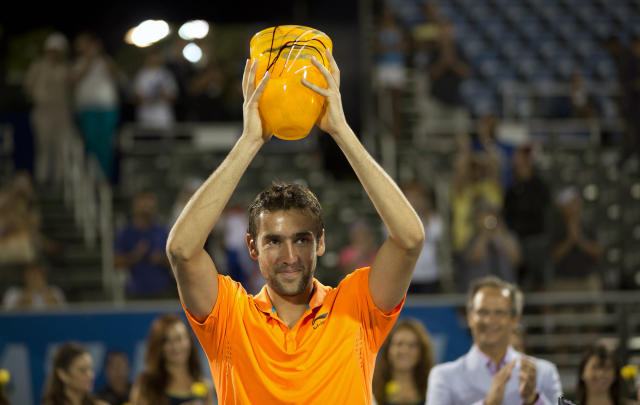 Marin Cilic, of Croatia, displays the winner's trophy after defeating Kevin Anderson in the Delray Beach Open tennis tournament, Sunday, Feb. 23, 2014, in Delray Beach, Fla. Cilic won 7-6 (6), 6-7 (7), 6-4. (AP Photo/J Pat Carter)
