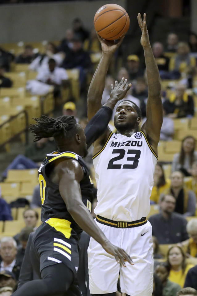 Missouri's Jeremiah Tilmon (23) shoots over Northern Kentucky's Silas Adheke during the second half of an NCAA college basketball game Friday, Nov. 8, 2019, in Columbia, Mo. Missouri won 71-56. (AP Photo/Jeff Roberson)