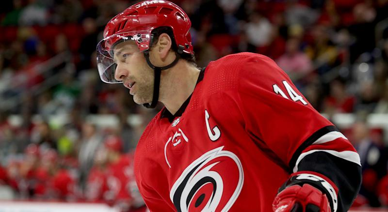 RALEIGH, NC - FEBRUARY 16: Justin Williams #14 of the Carolina Hurricanes skates for position on the ice during an NHL game against the Dallas Stars on February 16, 2019 at PNC Arena in Raleigh, North Carolina. (Photo by Gregg Forwerck/NHLI via Getty Images)