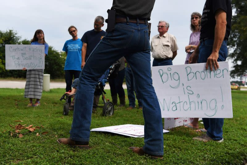 FILE PHOTO: Protesters gather against contact tracing in Conroe, Texas