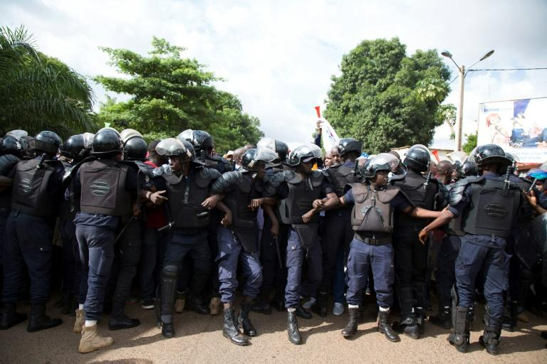 Security forces in Bamako line up to hold back the crowd at Sunday's march in support of President Ibrahim Boubacar Keita
