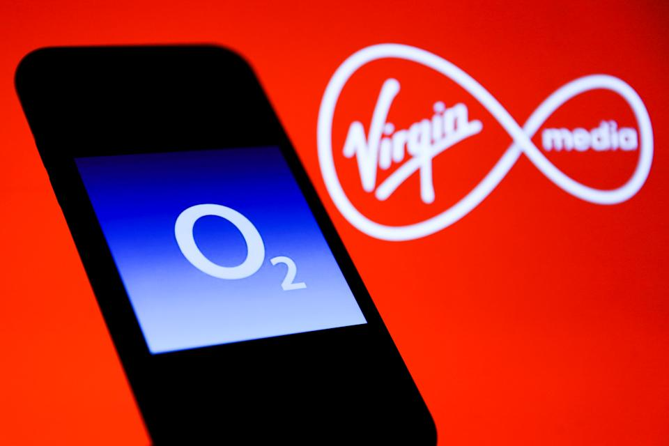 O2 logo is seen displayed on a phone screen with Virgin Media logo displayed on the background in this illustration photo taken in Poland on November 19, 2020. (Photo by Jakub Porzycki/NurPhoto via Getty Images)