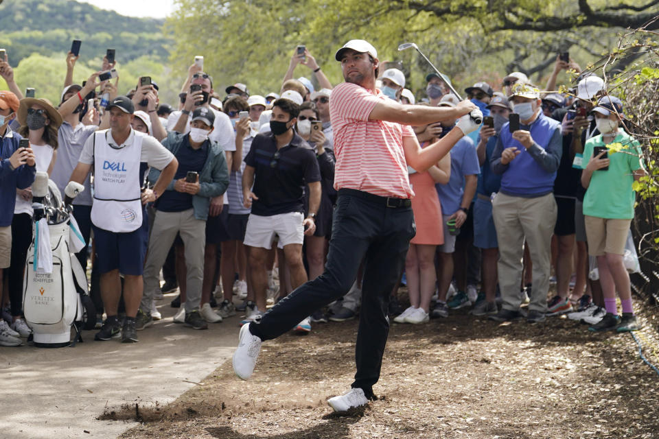 Scottie Scheffler follows through on his third shot on hole No. 6 during the final round of the Dell Technologies Match Play Championship golf tournament Sunday, March 28, 2021, in Austin, Texas. (AP Photo/David J. Phillip)