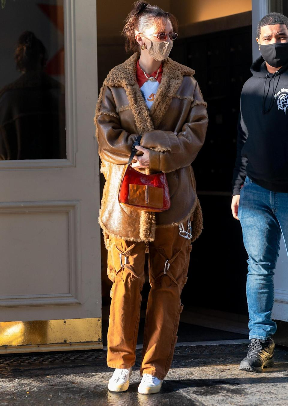 <p>Bella Hadid bundles up in a cozy brown coat as she steps out in N.Y.C.'s Soho neighborhood on Monday.</p>
