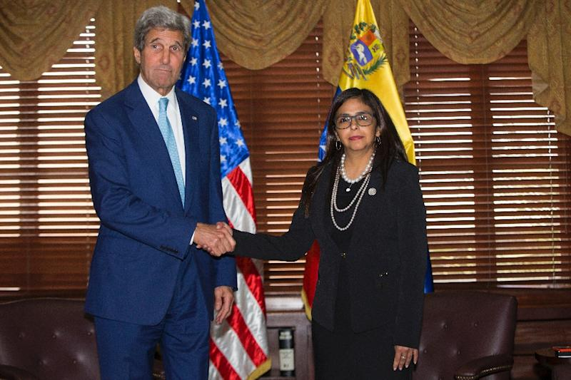 US Secretary of State John Kerry with Venezuelan Foreign Minister Delcy Rodriguez during the General Assembly of the Organization of American States, on June 14, 2016, in Santo Domingo, Dominican Republic