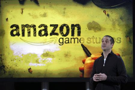 Amazon's vice president of games, Mike Frazzini speaks to media as he displays the Amazon Fire TV during a news conference in New York, April 2, 2014. REUTERS/Eduardo Munoz