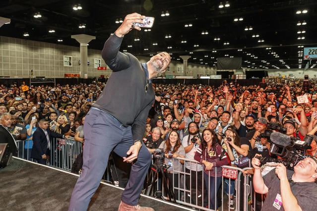 <p>The Rock made sure to take a crowd selfie while attending an event at Stan Lee's Los Angeles Comic-Con at the Los Angeles Convention Center on Saturday. (Photo: Rich Polk/Getty Images for Entertainment Weekly) </p>