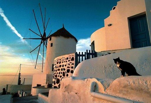 This undated picture shows sunset at the island of Santorini. Most of Santorini's hotels are currently near-empty but despite that, a double room with a caldera view can easily cost 300 euros ($395) a night, and suites are often priced at over 700 euros