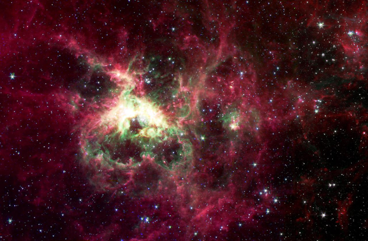 NASA's new Spitzer Space Telescope, formerly known as the Space Infrared Telescope Facility, has captured in stunning detail the spidery filaments and newborn stars of the Tarantula Nebula, in this image released Tuesday, Jan. 13, 2004, a rich star-forming region also known as 30 Doradus. This cloud of glowing dust and gas is located in the Large Magellanic Cloud, the nearest galaxy to our own Milky Way, and is visible primarily from the Southern Hemisphere. This image of an interstellar cauldron provides a snapshot of the complex physical processes and chemistry that govern the birth and death of stars. (AP Photo/NASA/JPL/Caltech/B. Brandl)