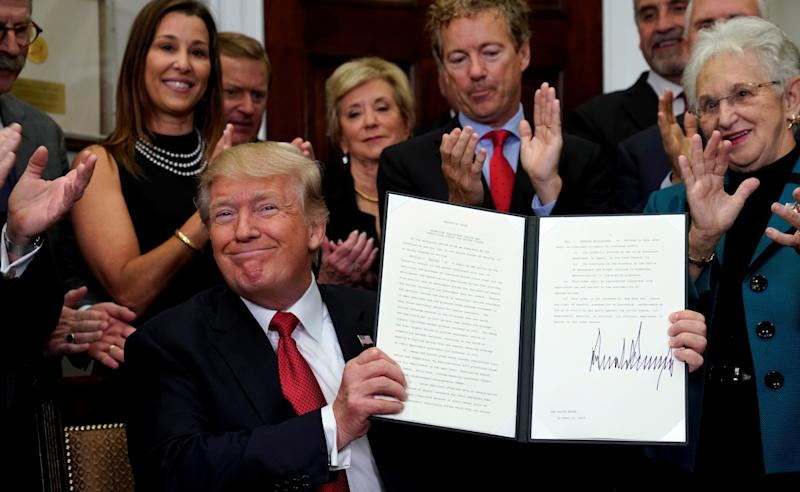 <strong>Trump celebrates after signing the Executive Order.</strong>