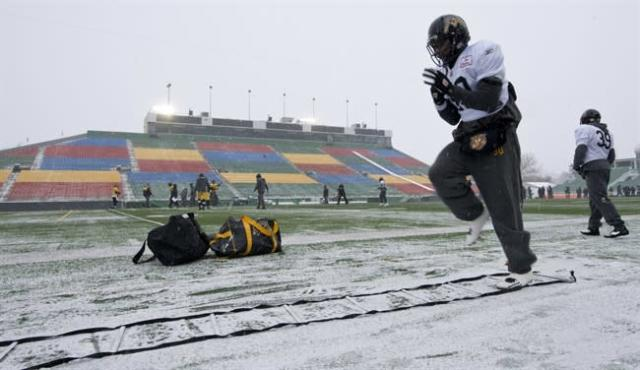 Hamilton Tiger-Cats fullback Dahrran Diedrick goes through drills during a practice, Wednesday November 20, 2013 in Regina. The Tiger-Cats will face the Saskatchewan Roughriders Sunday in the 101st CFL Grey Cup. THE CANADIAN PRESS/Paul Chiasson