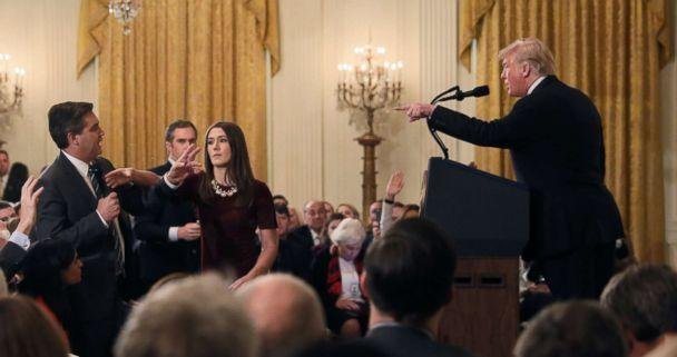 PHOTO: A White House staff member reaches for the microphone held by CNN's Jim Acosta as he questions President Donald Trump during a news conference following Tuesday's midterm elections at the White House in Washington, Nov. 7, 2018. (Jonathan Ernst/Reuters)