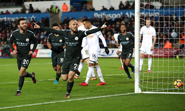 David Silva scored twice in Manchester City`s 4-0 win at Swansea, setting a Premier League record of 15 straight victories.