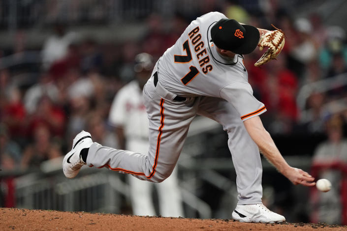 San Francisco Giants relief pitcher Tyler Rogers (71) throws in the eighth inning of a baseball game against the Atlanta Braves, Saturday, Aug. 28, 2021, in Atlanta. (AP Photo/John Bazemore)