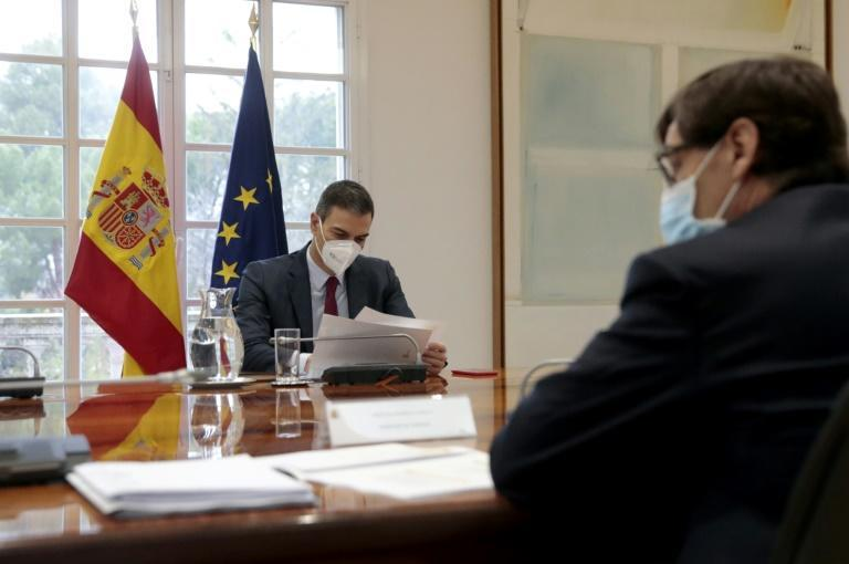 Spanish Prime Minister Pedro Sanchez (L) has gone into self isolation after contact with Macron
